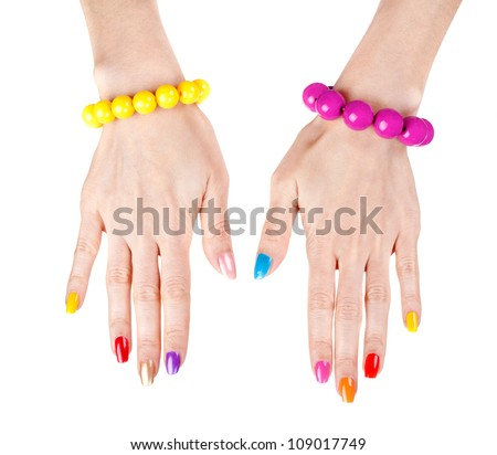 Women's hands with a fashionable multi-colored nail polish with the bracelets. Studio, isolate on white.