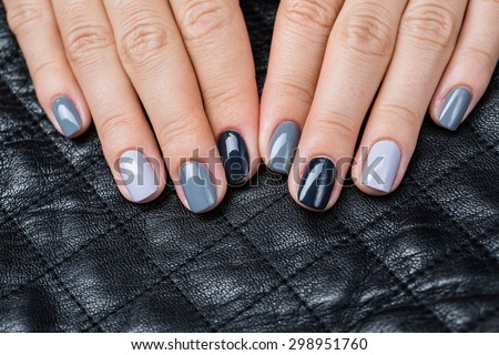 Women\'s hands with a stylish manicure.