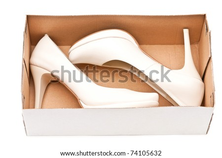 Women's high heels shoes in box isolated on white background