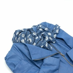 Women's jacket made of blue genuine soft leather. Closure - slanting zipper. Accessory - dark blue scarf with white circles. Isolated on a white background.