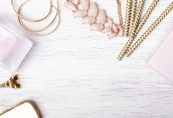 Women's jewelry and other stuff of pink and golden color