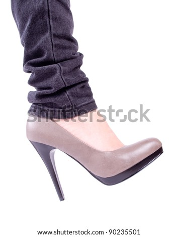 Women's leg in brown shoes isolated