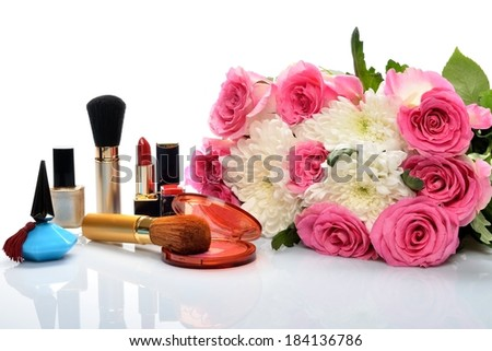 Women\'s perfumes, cosmetics and a bouquet of flowers in still life