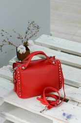 Women's red bag on a table