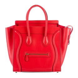 Women's Red Mini Luggage Handbag Isolated on White. Side View of Luxury Genuine Full Grain Leather Lady Shopping Tote Bag. Women Top Handle Shopper Handbags. Fashion Accessories