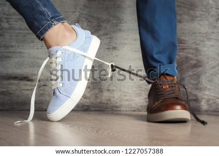 Women's shoe goes away from men's. Concept of breaking family relationships or quarrels