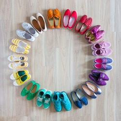 Women's shoes are in a circle. Rainbow.