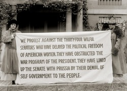 Women's suffrage activists protest the U.S. Senate's failure to pass the federal woman suffrage amendment in 1918.