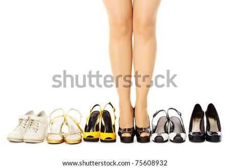 Women's summer shoes and female legs on floor. Lot of different clothes for any weather