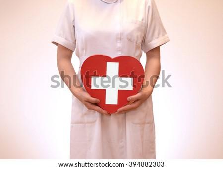 Women's white coat - Shutterstock ID 394882303