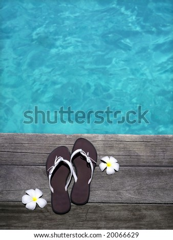 women sandals on  wooden floor with flowers near the water, summer, vacation, spa