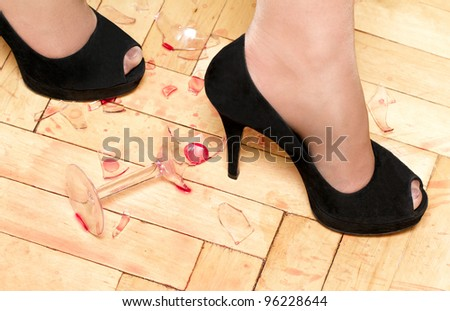 women shoes walking on broken glass