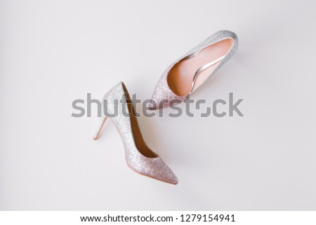 37d5e5c7c3 Women silver and pink glitter stylish high heel shoes on white background.  Beauty and fashion