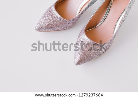 2f0f13baef7 Women silver and pink glitter stylish high heel shoes on white background.  Beauty and fashion
