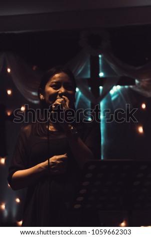 Women sing worship songs in church #1059662303