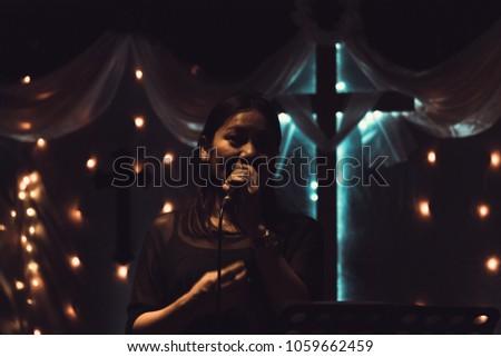 Women sing worship songs in church #1059662459