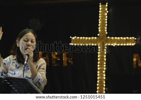 Women sing worship songs in church #1251015451