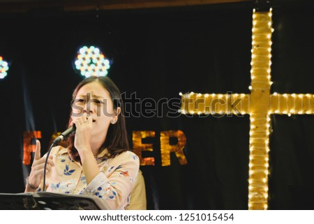 Women sing worship songs in church #1251015454