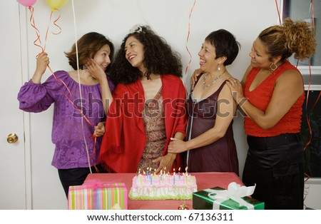 Women socializing at a birthday party