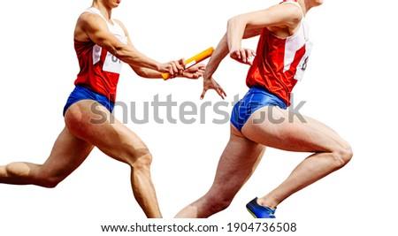 women sprinters runners passing relay baton run on a white background Foto d'archivio ©