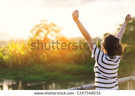 women standing a outdoor with sunset light in countryside for relaxing  #1247568016