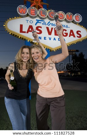 Women standing in front of welcome sign