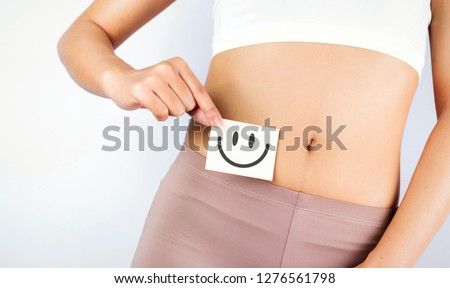 Women Stomach Health. Healthy Female With Beautiful Fit Slim Body  Holding White Card With Happy 