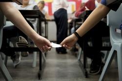 Women students cheating the exam