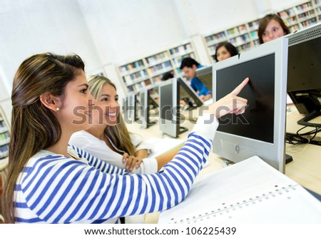 Women studying together on a computer lab