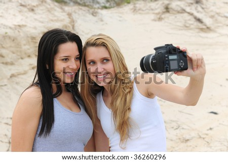 women taking a self-portrait on the beach