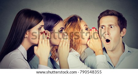 Women telling gossip and sharing with rumors talking to man on gray.