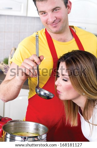 women testing the food prepared by they husband at home