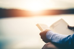 Women tourists read books in quiet nature.