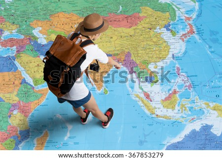women traveler is planning a...