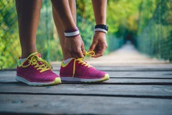 Women tying sports shoes
