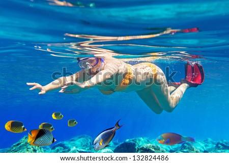 Women underwater in Aegean Sea of Greece