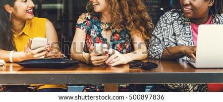 Women Using Digital Device Concept #500897836