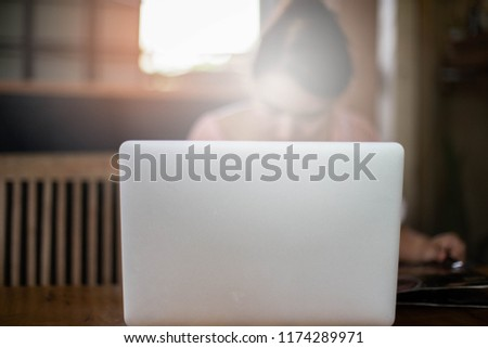 Women using laptop at cafe,female reading menu food on wooden chair,selective focus.