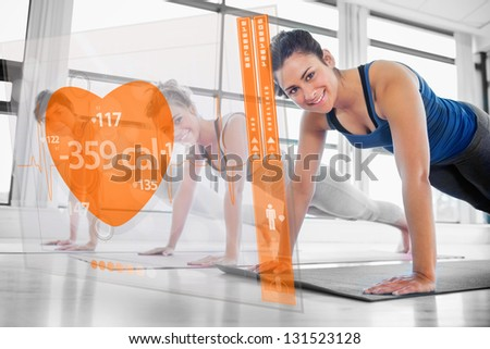 Women using modern orange interface at the gym