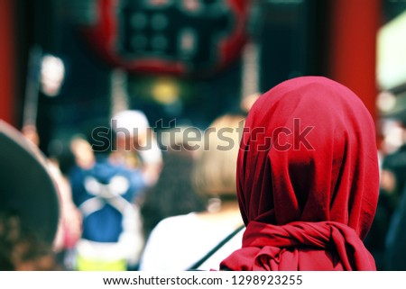 women visits  temple #1298923255