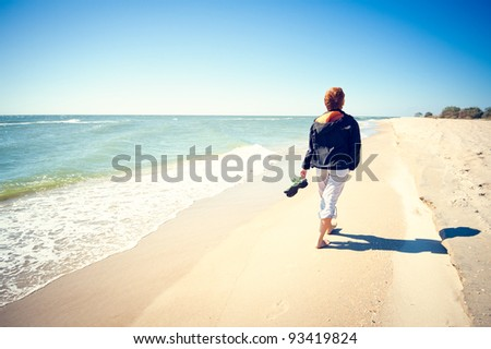 Women walk along the sea on the beach by