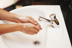 women washing hands with sanitizer soap and water after using a public restroom.prevent the spread of germs and bacteria and avoid infections corona virus,Coronavirus originating in China,Wuhan