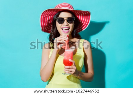Women wear dresses. She was drinking watermelon smoothie In the summer She feels refreshed.