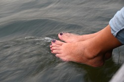 Women wear jeans and paint their toenails in crimson,sit at the pier or at the wooden bridge and soak their feet in the river in  evenings when the sun goes down.Feet feel cold of fast flowing river
