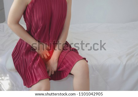 Women wear red skirt Use the hand to scratch the vagina.Genital itching caused by fungus in underwear.