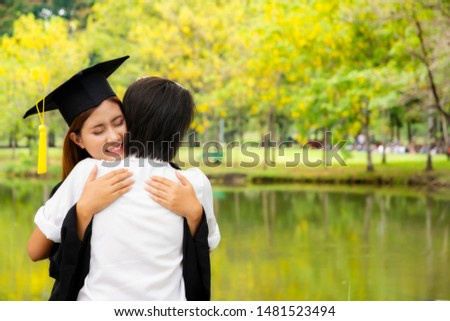 Women wearing a graduation gown embraced with the mother who came to congratulate the daughter who graduated. #1481523494