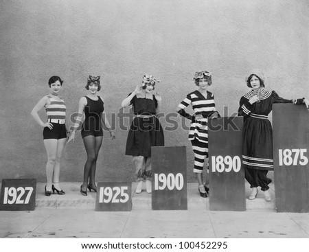 Women wearing fashions of different eras
