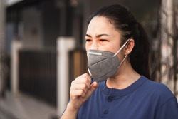 women wearing hygienic mask to prevent the virus PM2.5 and Coronavirus. People in masks The outbreak of Novel Corona virus (2019-nCoV) in Wuhan China. air pollution, Environmental awareness concept