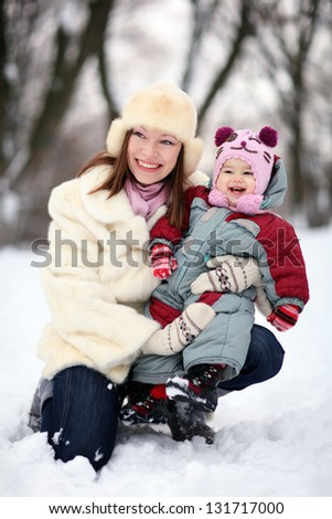 Women with baby in winter