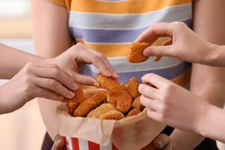 Women with bucket of tasty nuggets, closeup